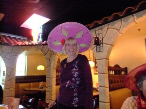 Red H. Carol Rafferty dons her sombrero given to her by Fiesta Mexicana staff!