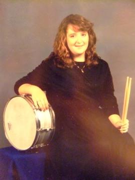Ali Holshouser, 16, playing percussion for Enloe High School Wind Ensemble, 1990