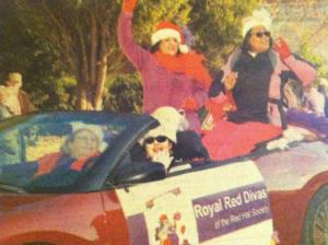 Royal Red Divas in the Youngsville Christmas Parade, 2012. Lorna Harris in back foreground, Monica Richardson i back waving Annie Holshouser driving, Helen Holshouser beside her in front.