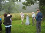 Pat Spangler in the Hat, and harvie Spangler tell the group all about the Meadows of Dan Baptist Church being founded by Steptoe and his brother William, and in this picture flank the monument to james Steptoe Langhorne.