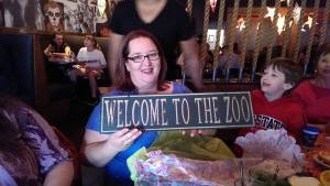 Ali at 40th birthday party with Welcome to the Zoo sign!