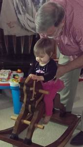 Evie and Grandaddy Max, try out her new rocking horse made by Max.Easter, 2015