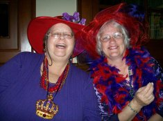 Royal Red Divas Helen Y. Holshouser, l, with Linda Mclaughlin in boa