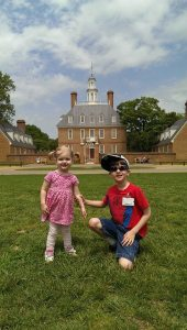 Katy and Liam, grandchildren of author, in front of the Governor's Palace, designed by their 10th Great Grandfather, Henry Cary