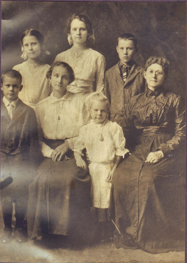 From left to right. Back Row; Pauline Bonnett, Florence Bonnett and Claude Bonnett.  Front Row Harry Bonnett, Bessie Barney Bonnett, Verna Bonnett, and Mary Guyette Barney Douglas. Picture taken about 1913.