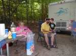 Cooking out with Aunt Brenda and Uncle Curt while they are camping at Falls Lake, l to r, Ali, Greg, and Liam.
