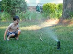 Liam have fun in the sprinkler!